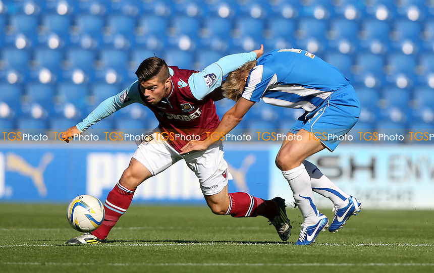 Elliott Lee of West Ham and Bradley Hamilton of Colchester - Colchester United Development Squad vs West Ham United Development Squad, Friendly at The Weston Homes Community Stadium - 16/10/12 - MANDATORY CREDIT: Rob Newell/TGSPHOTO - Self billing applies where appropriate - 0845 094 6026 - contact@tgsphoto.co.uk - NO UNPAID USE.