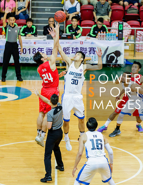The opening tip between Wu Cheuk Pan #30 of Eastern Long Lions and Nixon Nigel Thomas #24 of SCAA Men's Basketball Team  during the Hong Kong Basketball League game between Eastern Long Lions and SCAA at Southorn Stadium on May 29, 2018 in Hong Kong. Photo by Yu Chun Christopher Wong / Power Sport Images