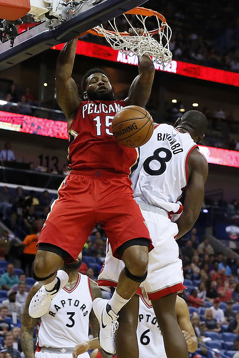 NEW ORLEANS, LA - MARCH 26: Alonzo Gee #15 of the New Orleans Pelicans dunks over Bismack Biyombo #8 of the Toronto Raptors during the first half of a game at the Smoothie King Center on March 26, 2016 in New Orleans, Louisiana. NOTE TO USER: User expressly acknowledges and agrees that, by downloading and or using this photograph, User is consenting to the terms and conditions of the Getty Images License Agreement.  (Photo by Jonathan Bachman/Getty Images)