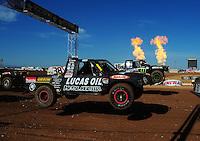 Apr 16, 2011; Surprise, AZ USA; LOORRS driver Brian Deegan (38) jumps alongside Cameron Steele (16) during round 3 at Speedworld Off Road Park. Mandatory Credit: Mark J. Rebilas-.