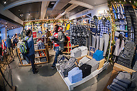 Shopping at American Eagle Outfitters in the Herald Square shopping district in New York on Thanksgiving Day, Thursday, November 26, 2015. Many retailers opened their doors on Thanksgiving day including some in Herald Square hoping to capture the dollars from shoppers after the parade. (© Richard B. Levine)