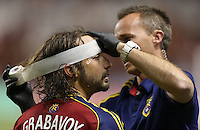 Ned Grabavoy (l) of Real Salt Lake is bandaged up by a trainer during a game against D.C. United during the second half of the U.S. Open Cup Final on October  1, 2013 at Rio Tinto Stadium in Sandy, Utah. DC United beat Real Salt Lake 1-0 to win the championship.