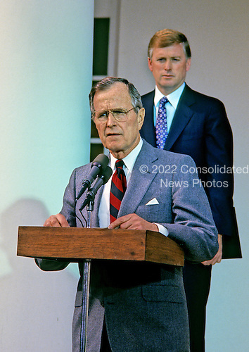 United States President George H.W. Bush makes a statement in the Rose Garden of the White House in Washington, D.C. rejecting the proposed Soviet peace agreement in the Gulf War with Iraq on February 22, 1991.  U.S. Vice President Dan Quayle looks on from behind .Credit: Howard L. Sachs / CNP