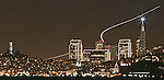 The San Francisco skyline sparkles with holidays lights viewed from a fishing pier from Fort Baker Sausalito as airline traffic on Thanksgiving weekend, the most business travel weekend of the year, leaves a trail of lights from SFO to points unknown. .