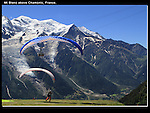 France, Chamonix.  <br /> I made a nice composition and waited for the paragliders and cable car to pass through the frame. This allows me to include Mt Blanc and Chamonix below.