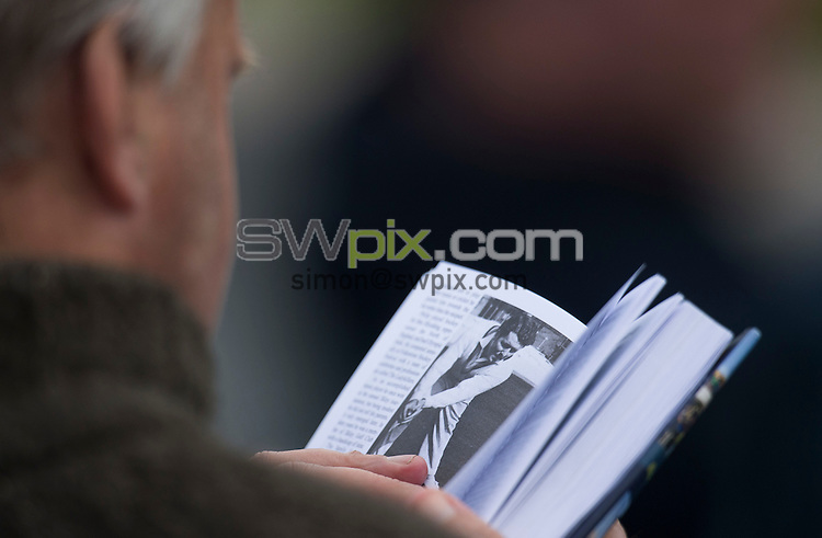 Picture by Allan McKenzie/SWpix.com - 26/04/2015 - Cricket - LV County Championship Div One - Yorkshire County Cricket Club v Warwickshire County Cricket Club - Headingley Cricket Ground, Leeds, England - Yorkshire's fans and supporters reading yearbooks at the ground.