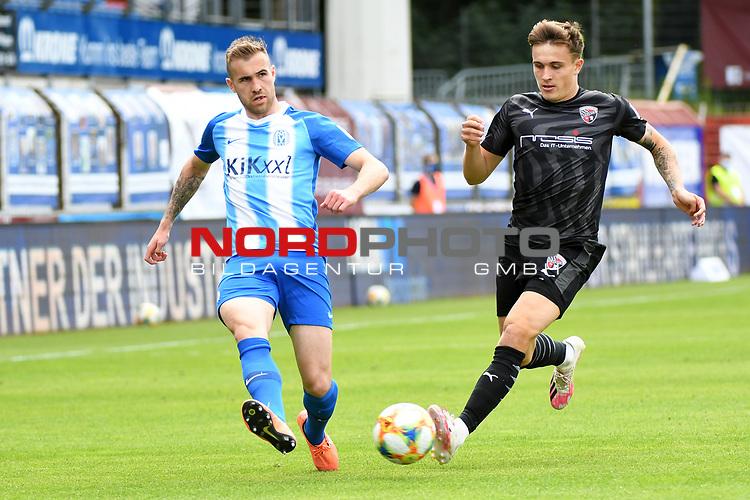 28.06.2020, Hänsch-Arena, Meppen, GER, 3.FBL, SV Meppen vs. FC Ingolstadt 04 <br /> <br /> im Bild<br /> Marco Komenda (SV Meppen, 6) und Dennis Eckert (FC Ingolstadt 04, 7) im Zweikampf, Duell, Laufduell.<br /> <br /> <br /> DFL REGULATIONS PROHIBIT ANY USE OF PHOTOGRAPHS AS IMAGE SEQUENCES AND/OR QUASI-VIDEO<br /> <br /> Foto © nordphoto / Paetzel