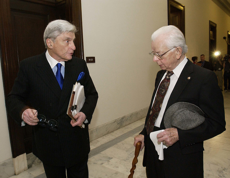 05/19/05.CENTRISTS/JUDICIAL NOMINATIONS--Sen. John W. Warner, R-Va., and Sen. Robert C. Byrd, D-W.Va., leave an 11 a.m. meeting in the office of Sen. John McCain, R-Ariz., of a group of Democrat and Republican Senate moderates and mavericks trying to hammer out a deal to avert a parliamentary showdown over President Bush's judicial nominees..CONGRESSIONAL QUARTERLY PHOTO BY SCOTT J. FERRELL