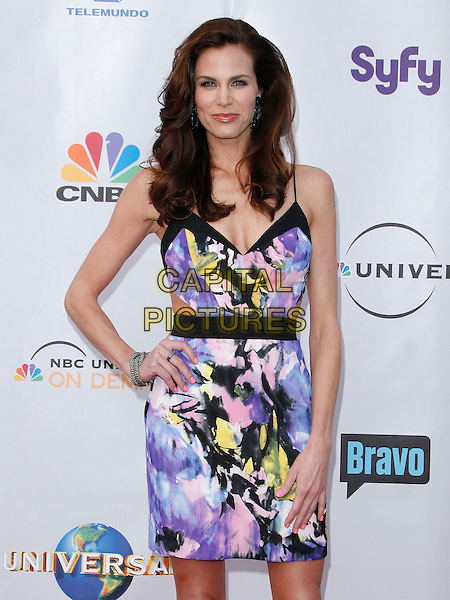 BROOKE BURNS. arriving at the The Cable Show 2010 To Feature An Evening With NBC Universal held at  Universal Studios Hollywood in Universal City, California, USA, .May 12th, 2010..half length purple print dress hand on hip  blue cut out yellow white black .CAP/ROT/AMB.©Adriana M. Barraza /Roth Stock/Capital Pictures