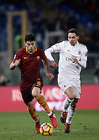 Calcio, Serie A: Roma vs Milan. Roma, stadio Olimpico, 12 dicembre 2016.<br /> Roma's Diego Perotti, left, is challenged by Milan's Mattia De Sciglio during the Italian Serie A football match between Roma and AC Milan at Rome's Olympic stadium, 12 December 2016.<br /> UPDATE IMAGES PRESS/Isabella Bonotto