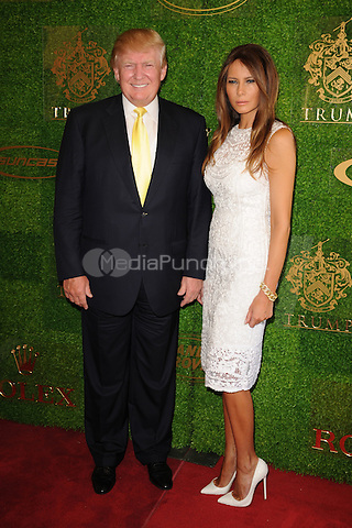 PALM BEACH FL - JANUARY 4:  Donald Trump and Melania Trump attend The Trump Invitational Grand Prix at Club Mar-a-Lago on January 4, 2015 in Miami, FL Florida. Credit: mpi04/MediaPunch