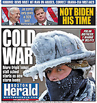 Boston Herald front page for January 2, 2018 featuring Lynn firefighter Bobby Lehman covered in ice from battling a three-alarm fire in Nahant on January 1, 2018.