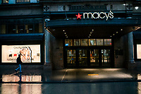 NEW YORK, NY - April 13:  A man walks in front of Macy's flagship store that remains shuttered due to COVID-19 pandemic on April 13, 2020. in New York, United States. The global economy is facing the worst collapse since the WWII, while COVID-19  pandemic has now killed more than 22,000 people in the United States and at least 1,864,629 people died world wide. (Photo by Eduardo MunozAlvarez/VIEWpress)