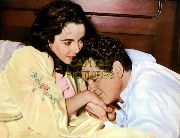 ELIZABETH TAYLOR & ROCK HUDSON.in Giant (1956).*Filmstill - Editorial Use Only*.CAP/STF/PEL.Supplied by Capital Pictures.
