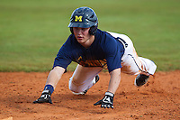 Michigan Wolverines outfielder Patrick Biondi #26 dives back to first during a game against the Seton Hall Pirates at the Big Ten/Big East Challenge at Al Lang Stadium on February 18, 2012 in St. Petersburg, Florida.  (Mike Janes/Four Seam Images)