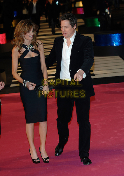 "JEMIMA KHAN & HUGH GRANT.At the UK Film Premiere of ""Music & Lyrics"",.Odeon Leicester Square, .London, England, February 5th 2007..full length Goldsmith couple black dress hand pointing gesture.CAP/PL.©Phil Loftus/Capital Pictures"