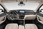 Stock photo of straight dashboard view of 2020 BMW X1 X-Line 5 Door SUV Dashboard