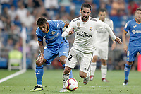 Real Madrid's Isco Alarcon (r) and Getafe CF's Damian Suarez during La Liga match. August 19,2018.  *** Local Caption *** &copy; pixathlon<br /> Contact: +49-40-22 63 02 60 , info@pixathlon.de