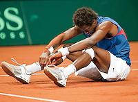 18-9-09, Netherlands,  Maastricht, Tennis, Daviscup Netherlands-France, Gaile Monfils  gaat onderuit
