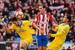 Atletico de Madrid Diego Godín and UD Las Palmas Pedro Bigas and Angel Montero during La Liga match between Atletico de Madrid and UD Las Palmas at Vicente Calderon Stadium in Madrid, Spain. December 17, 2016. (ALTERPHOTOS/BorjaB.Hojas)