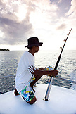 INDONESIA, Mentawai Islands, mid adult man fishing from a boat
