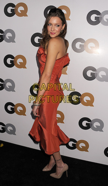 Katie Cassidy.Arriving at the GQ Men Of The Year Party at Chateau Marmont Hotel in Los Angeles, California, USA..November 13th, 2012.full length dress side orange strapless  .CAP/ROT/TM.©Tony Michaels/Roth Stock/Capital Pictures