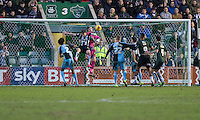 Barry Richardson of Wycombe Wanderers punches a cross under pressure from GreggWylde of Plymouth Argyle during the Sky Bet League 2 match between Plymouth Argyle and Wycombe Wanderers at Home Park, Plymouth, England on 30 January 2016. Photo by Mark  Hawkins / PRiME Media Images.