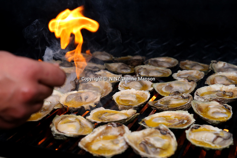 The Ascot Hotel Emberz food stall barbequed Bluff oysters with garlic butter at the Bluff Oyster and Food Festival, Bluff, New Zealand, Saturday, May 21, 2016. Credit:  Dianne Manson