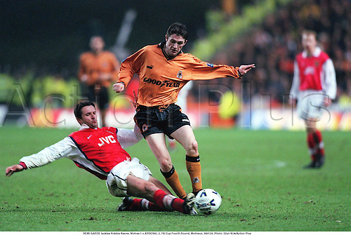 REMI GARDE tackles Robbie Keane, Wolves 1 v ARSENAL 2, FA Cup Fourth Round, Molineux, 990124. Photo: Glyn Kirk/Action Plus...1999.slide-tackle.Soccer.Aggression.football.premiership premier league.club clubs.tackle tackles tackling tackled.foul fouls fouling fouled