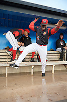 Batavia Muckdogs first baseman Lazaro Alonso (19) jokingly hovers over the flooded dugout during a rain delay during a game against the West Virginia Black Bears on June 24, 2017 at Dwyer Stadium in Batavia, New York.  The game was suspended in the bottom of the third inning and completed on June 25th with West Virginia defeating Batavia 6-4.  (Mike Janes/Four Seam Images)