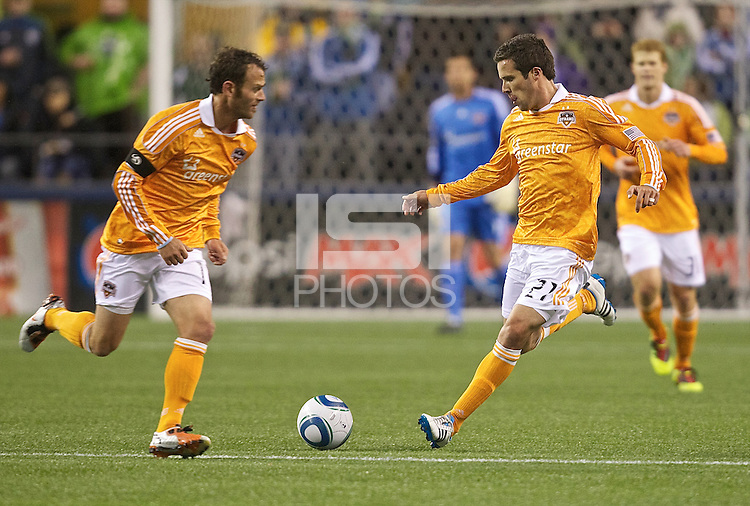 Houston Dynamo midfielder Hunter Freeman, right, and midfielder Hunter Freeman cross paths while taking the ball up field during play against the Seattle Sounders FC at Qwest Field in Seattle Friday March 25, 2011. The match ended in a 1-1 draw.