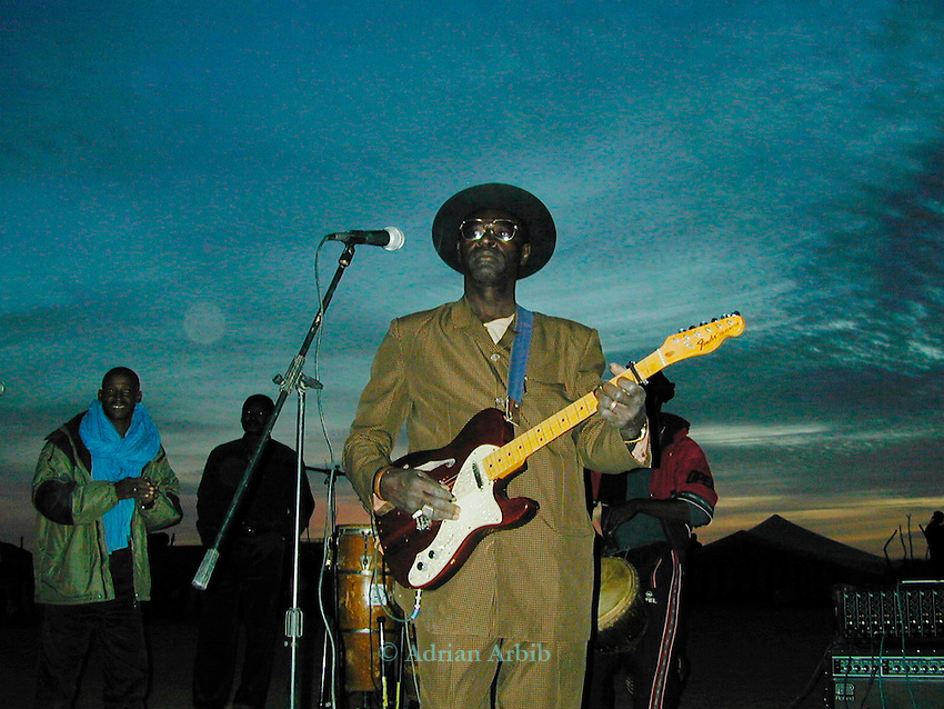The Malian musician Ali Farka Toure playing in the  Sahara desert in Mali, Tombouctou, Mali - on new years eve 1999/2000.