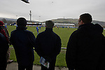 Glossop North End 0 Barnoldswick Town 1, 19/02/2011. Surrey Street, North West Counties League Premier Division. Glossop North End supporters at the club's Surrey Street ground watching as their club play Barnoldswick Town (in yellow) in the Vodkat North West Counties League premier division. The visitors won the match by one goal to nil watched by a crowd of 203 spectators. Glossop North End celebrated their 125th anniversary in 2011 and were once members of the Football League in England, spending one season in the top division in 1899-00. Photo by Colin McPherson.