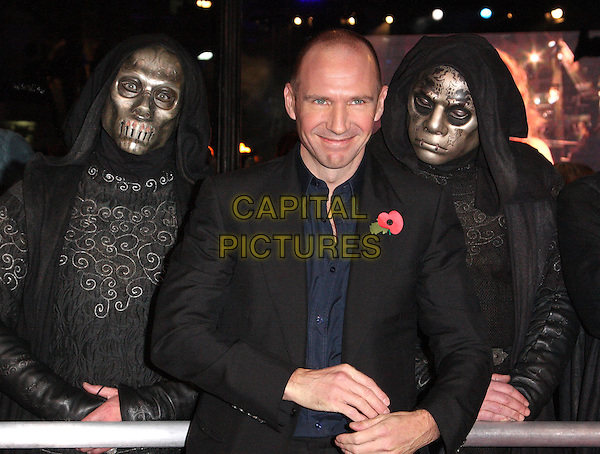 "RALPH FIENNES .""Harry Potter And The Deathly Hallows: Part 1"" World Film Premiere, Empire cinema Leicester Square and Odeon Leicester Square, London, England, UK, .11th November 2010. .half length jacket suit  black navy poppy red blue shirt death eaters in background masks .CAP/ROS.©Steve Ross/Capital Pictures."