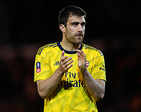 Sokratis Papastathopoulos of Arsenal applauds the Arsenal fans at the end of the match during Portsmouth vs Arsenal, Emirates FA Cup Football at Fratton Park on 2nd March 2020