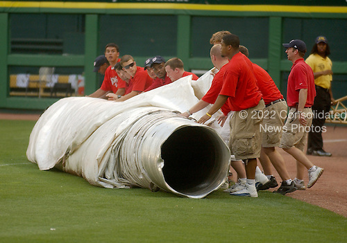 Washington, D.C. - July 5, 2005 --  Grounds crew rolls out the tarp in anticipation of severe thunderstorms prior to the second game as the New York Mets visit the Washington Nationals at RFK Stadium in Washington, D.C. on July 5, 2005..Credit: Ron Sachs / CNP.(RESTRICTION: NO New York or New Jersey Newspapers or newspapers within a 75 mile radius of New York City)
