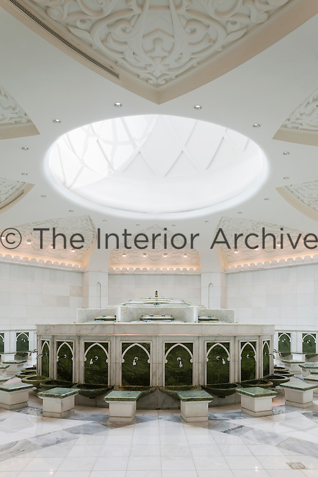 The Sheikh Zayed Grand Mosque in Abu Dhabi, also known as the White Mosque, is a masterpiece of architecture and craftsmanship. Below the mosque, the ablution area to cleanse before prayer.