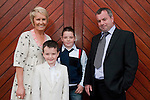 Ben Tracey who made his First Communion at St. Mary's Church on Saturday 16th May, pictured with mum and dad Paula and Kenneth and brother Shane.