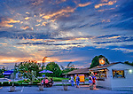 Photo by Phil Grout..When the thermometer is in the mid 80's, and there's a slight.breeze from the west, and sundown is having a nice display,.it's time to end the day with a cool sno-ball laced with your.favorite flavor.  The bucholic scene unfolds at Ice Planet in.Eldersburg.