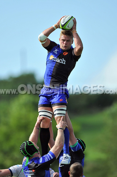 Lewis Evans wins lineout ball for the Dragons. Pre-season friendly match, between Bristol Rugby and Newport Gwent Dragons on August 17, 2014 at the Cribbs Causeway Ground in Bristol, England. Photo by: Patrick Khachfe / JMP