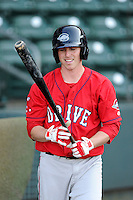 Infielder/third baseman Jimmy Rider (5) of the Greenville Drive waits his turn for batting practice on the team's Media Day first workout on Tuesday, April 1, 2014, at Fluor Field at the West End in Greenville, South Carolina. (Tom Priddy/Four Seam Images)
