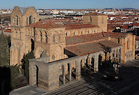 Basilica de San Vicente (St Vincent's Basilica), 12th century, attributed to Giral Fruchel, with the city in the background, Avila, Castile and Leon, Spain. Located just outside the city walls on the site of the martyrdom of St Vincent, this Romanesque Basilica of cruciform plan has three naves and three apses. Picture by Manuel Cohen