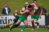 Notise Tauafoa gets scragged from behind by Keven Farrell as he runs from the base of a scrum. Counties Manukau McNamara Cup Premier Club Rugby final between Pukekohe andWaiuku, held at Bayer Growers Stadium, on Saturday July 17th. Waiuku won 25 - 20.