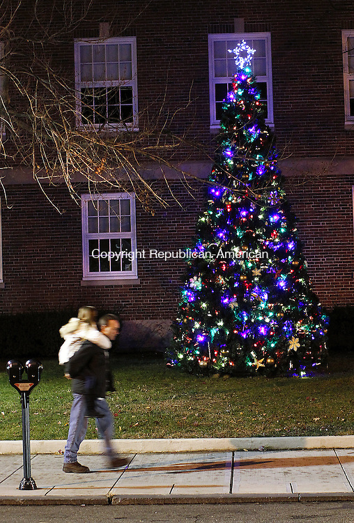 Torrington, CT- 26, November 2010-112610CM05 Olivia Lemieux, 10, gets a piggy-back-ride by her dad, John of Torrington past the Torrington City Hall Christmas Tree Friday night.  The city held it's Light Up Main event which featured a parade from Coe Memorial Park to the City Hall.  Mayor Ryan Bingham estimated the crowd it's biggest yet, with 2,000 attendees.  Christopher Massa Republican-American