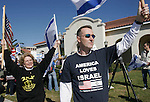 Gary Wilcox/Special...01/18/09... Missy Rothpearl and Mark Baker waves U.S. and Israeli flags during a rally in support of Israel at Jacksonville Beach City Hall Sunday. (01/18/09)