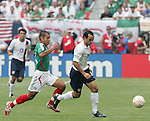 24 June 2007:  USA's Landon Donovan (10) is chased by Mexico's Jaime Lozano (l). The United States Men's National Team defeated the national team of Mexico 2-1 in the CONCACAF Gold Cup Final at Soldier Field in Chicago, Illinois.