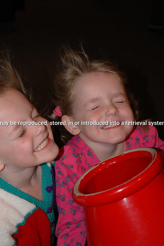 Two young girls having their hair blown at a the Ontario Science Centre