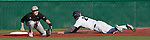 February 22, 2013: Northern Illinois Huskies third baseman Connor Duckhorn takes the throw as Nevada Wolf Pack runner Kewby Meyer slides saftly into the base during their NCAA baseball game played at Peccole Park on Friday afternoon in Reno, Nevada.