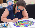 Artist Nicole Stirling paints during Art Fest on Saturday June 30, 2018 in downtown Reno.