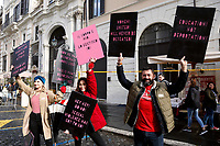Banners: show me what a feminist looks like! Show mw what democracy looks like<br /> Rome January 19th 2019. Women's March Rome, march of solidarity for the civil rights and civil rights for women, organized by the American community of Rome, simultaneously with the women's march that take place worldwide on January 19th.<br /> Foto Samantha Zucchi Insidefoto